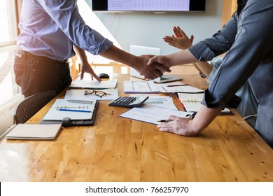 Business people shaking hands, finishing up a meeting. Two confident business man shaking hands during a meeting in the office, success, dealing, greeting and partner concept.