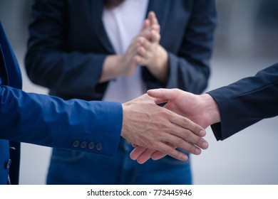 Business people shaking hands, good job, partnership, congratulations and business teamwork concept.