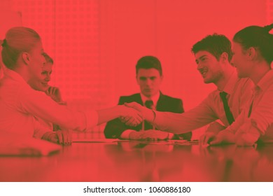business people shaking hands make deal and sign contract in bright modern officeduo tone