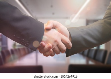 Business people shaking hands in the meeting room after successful meeting