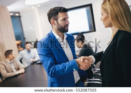 Business people shaking hands  in modern conference office