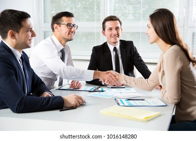 Business people shaking hands in an office