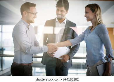 Business people shaking hands in office. Successful business people.