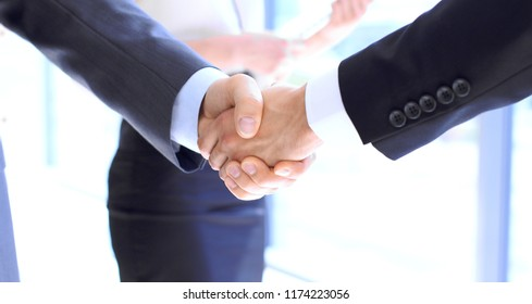 Business people shaking hands as a sign of agreement. Success concept