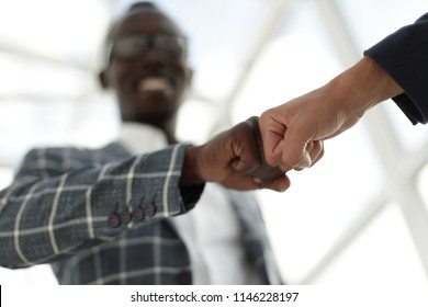 Business people showing Fist Bump after meeting