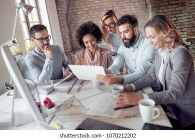 Business people showing team work while working in modern office.