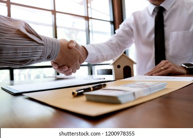 Business people signing contract making a deal with real estate agent Concept for consultant and home insurance concept