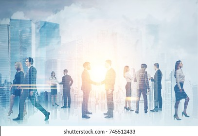 Business people silhouettes against a blurred cityscape background. Concept of a teamwork and communication. Double exposure toned image mock up