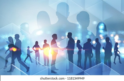 Business people silhouettes walking, talking and shaking hands over night city background. Partnership and sealing a deal concept. Toned image double exposure copy space