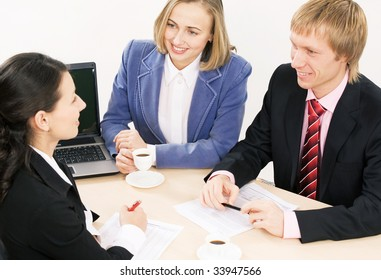 Business people sit at ? table and communicate