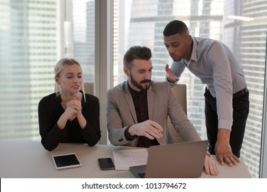 The business people sit at the table and work in the office.