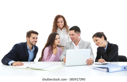 Business people sitting in front of a laptop