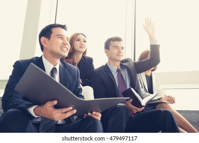 Business people sitting in group, sharing, meeting and learning