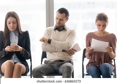 Business people sitting in row, tedious waiting for long time, meeting start delay, someone is late, getting bored, annoyed dissatisfied man looking at wristwatch, wait in queue for interview concept