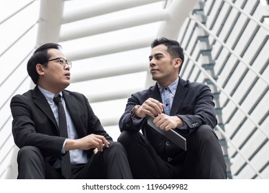 business people sitting to talk and discussing on stair