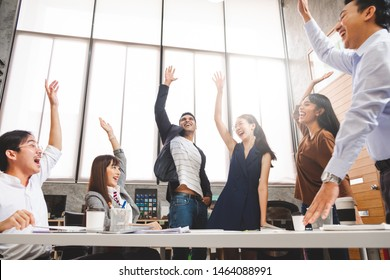 Business people smile and raise hands up, feeling happy, complete finish job, teamwork successful/achievement working in office concept