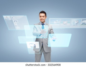 business, people, social networking, technology and mass media concept - happy smiling businessman in suit working with virtual screens