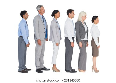 Business people standing behind the other in office