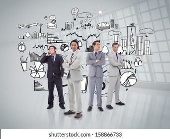 Business people standing in front of graphics on grey wall