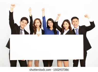 business people standing and holding blank board