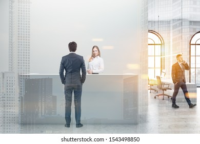 Business people standing near reception desk in modern office with white walls, arched windows and open space area in background. Toned image double exposure