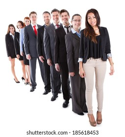 Business people standing in row over white background