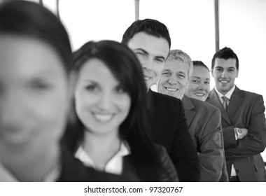 business people standing in a row with their arms folded