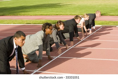 Business people at starting line