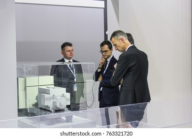 Business people at the storefront. St. Petersburg, Russia - 3 October, 2017. Participants and visitors of the annual St. Petersburg Gas Forum.