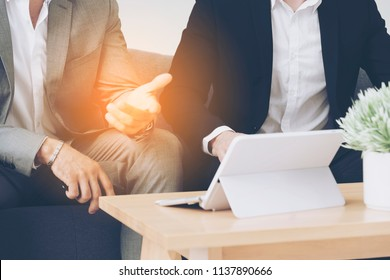 Business people or students gesturing and discussion sitting investors or accountants and online marketers or lawyers for digital document or contract agreement with coworkers. startup success concept