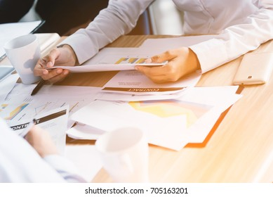 business people in suits sitting at desk working in team together, working with documents sign up contract, clipboard, folder with papers, business plan.