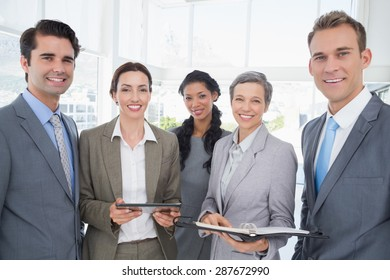 Business people with tablet and notebook in the office