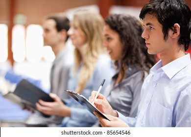 Business people taking notes during a presentation