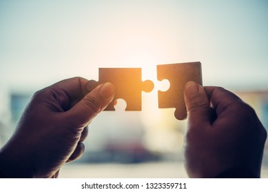 Business people are taking puzzles to connect. Ideas about building a business network.