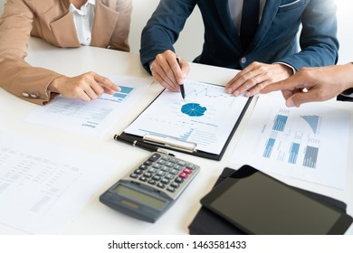 Business People Talking Discussing with coworker planning analyzing financial document data charts and graphs in Meeting and  successful teamwork Concept