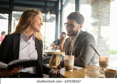 Business people talking and laughing together at cafe