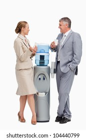 Business people talking next to the water dispenser  against white background