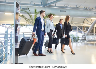 Business people as a business team with luggage on business trip in airport terminal