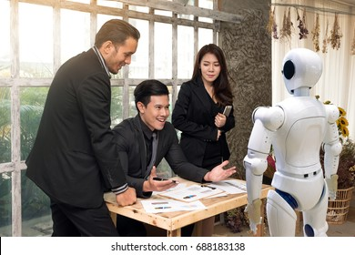 Business people team , manager and personal assistant automation robot video camera conference technology discussing together in conference room during meeting at office.