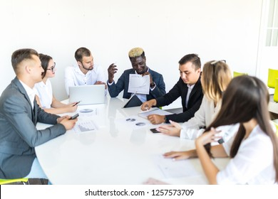Business people team at meeting working documents together in office