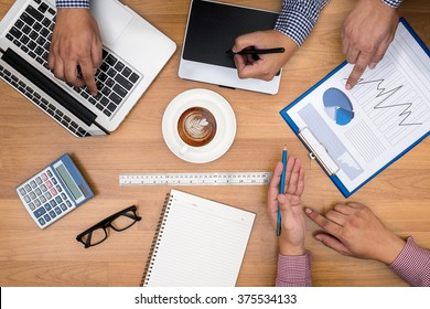 Business people team working together at office desk with laptop, tablet, financial paperwork , top view