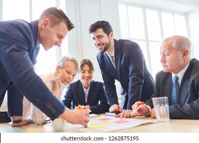 Business people in teambuilding workshop play creative game as team