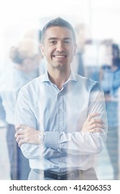 business, people and teamwork concept - smiling businessman with group of businesspeople meeting in office