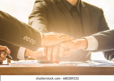 Business people teamwork up to create power synergy success