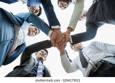 business people teamwork stacking hand or  joining hands