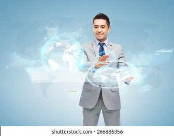 business, people and technology concept - happy smiling businessman in suit working with virtual screens over blue background