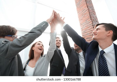 Business people with their hands together in a circle