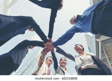 Business people with their hands together after meeting a deal to establish a startup business  company,startup and team work concept