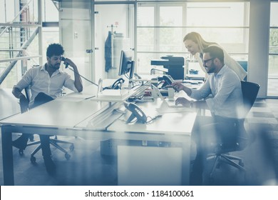 Business people together in office. Colleague reading document. African business man using Landline.