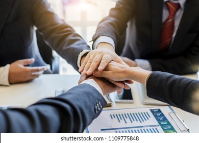 Business people together to work as a team to ensure the success of the business. Teamwork cooperation togetherness concept